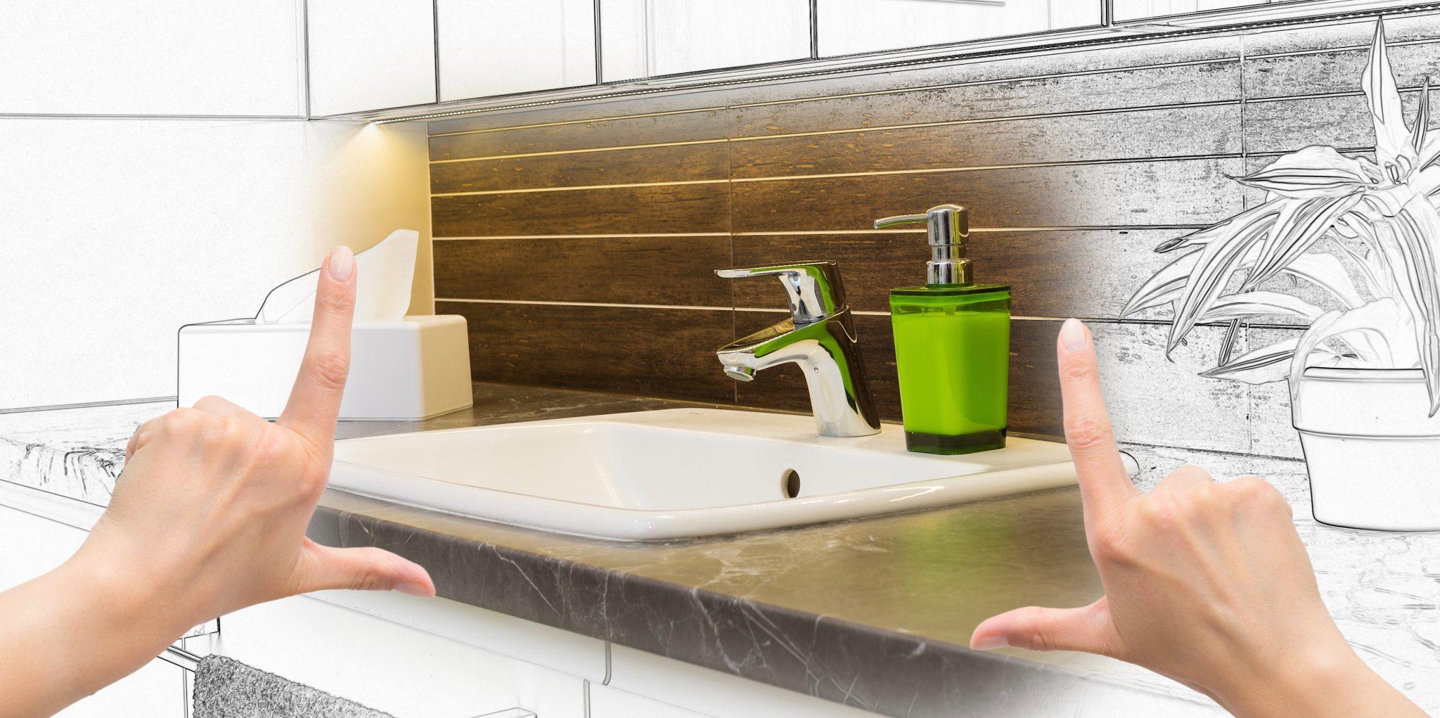 Female hands framing custom bathroom renovation design.