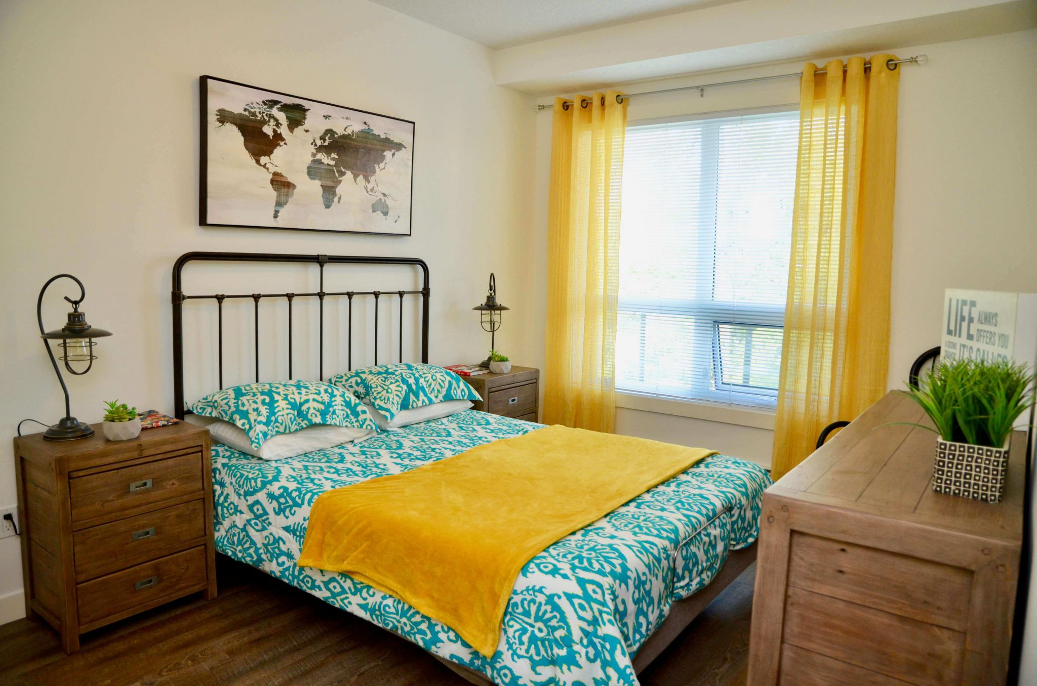 Condo master bedroom with queen bed, dresser and nightstands