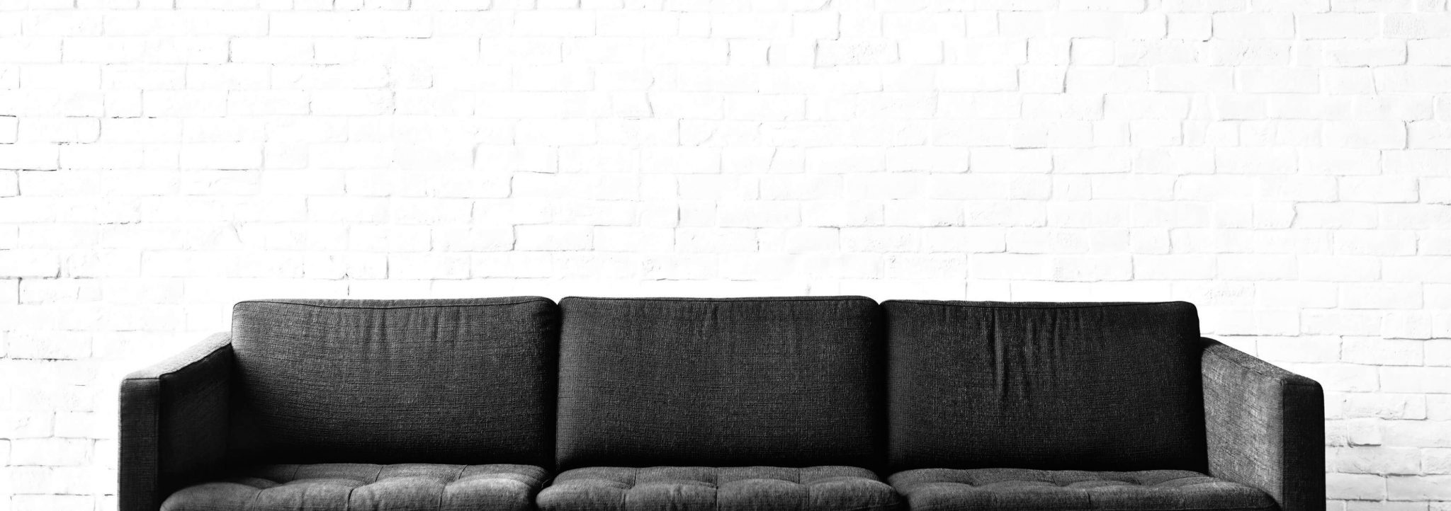 Couch with blank wall