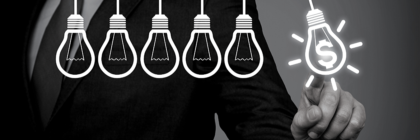 Light bulbs with man pointing to dollar sign.