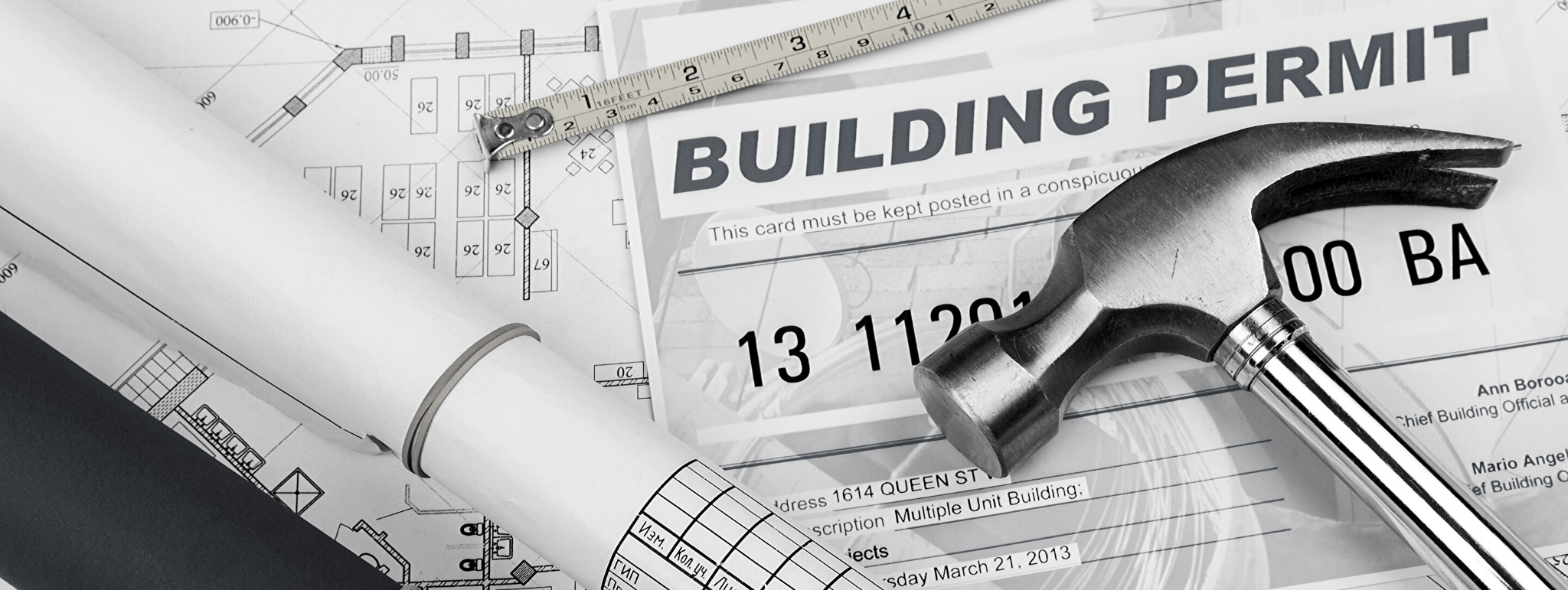 Building permit image with permits and a hammer