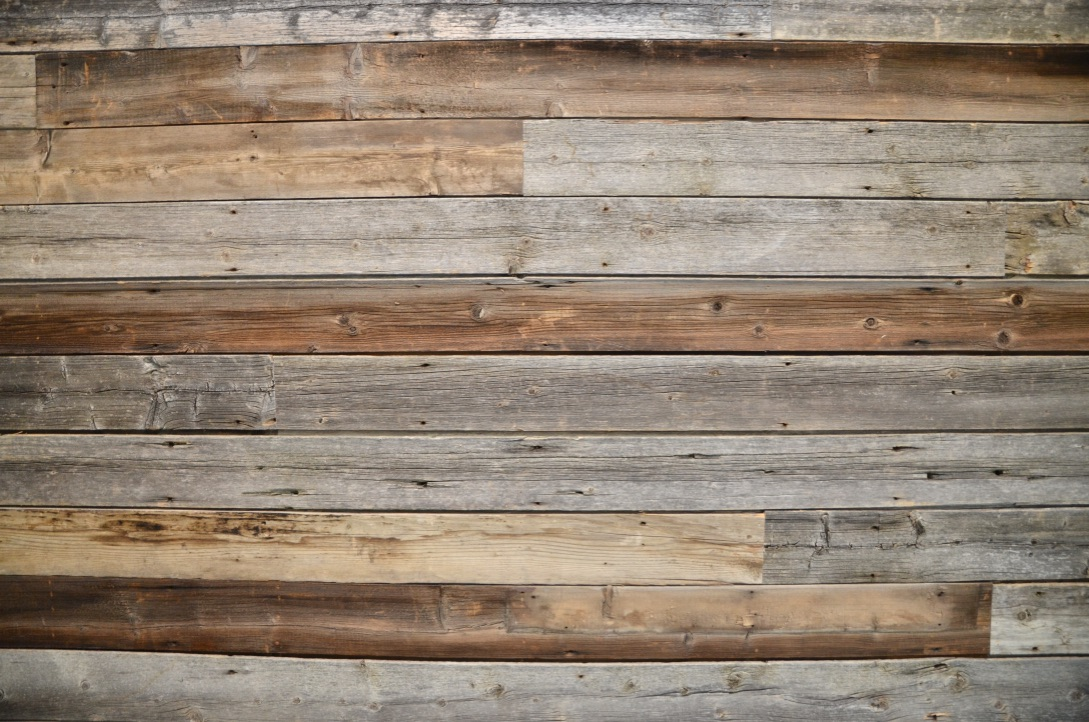 Bedrock Construction - custom barn wood wall